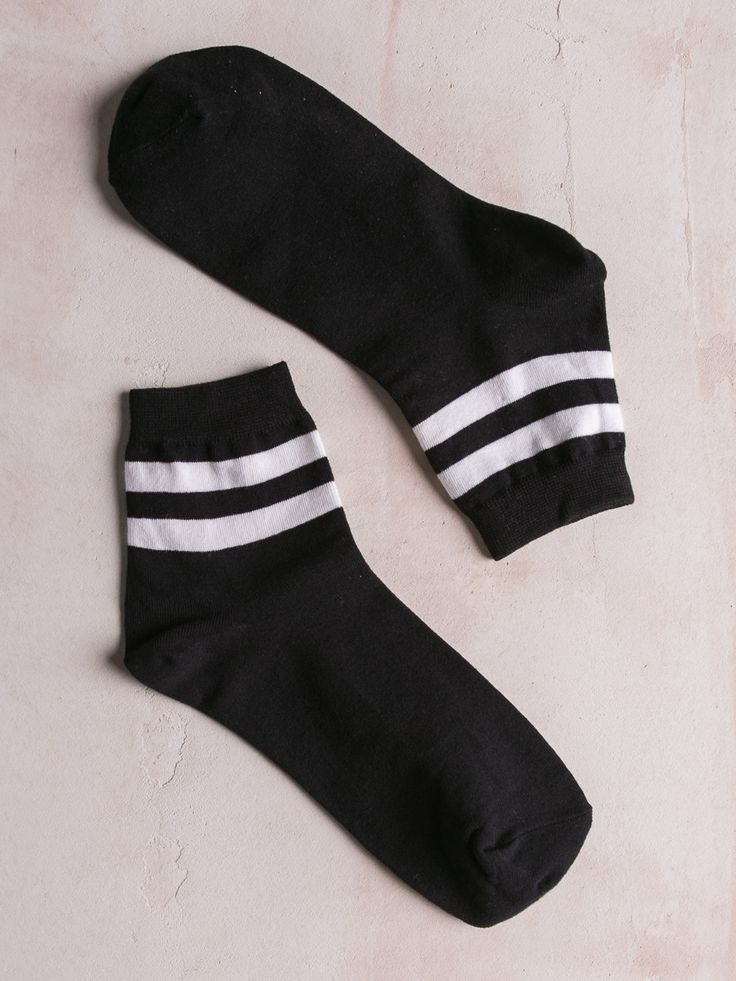 Rib knit crew socks with varsity stripe detail. One Size Fits Most 90% Cotton, 10% Spandex