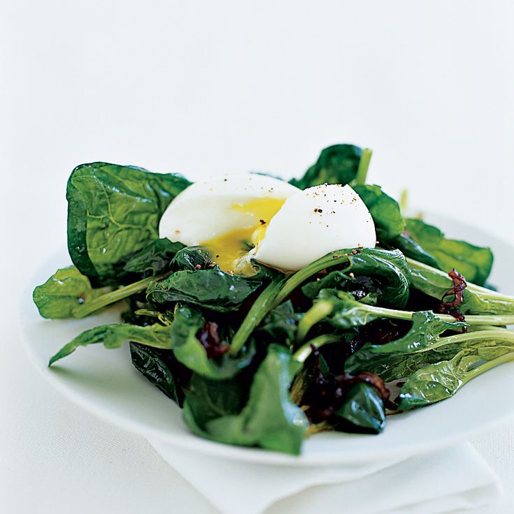 Warm Spinach Salad with Soft-Poached Eggs   Leafy greens like spinach provide a huge amount of nutrients, especially vitamin A and vitamin K.