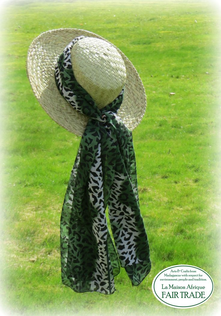 Fair Trade hat handcrafted of mountain grass. A thin textile from the Comoros tied around the hat crown. Green Life is Good Life.