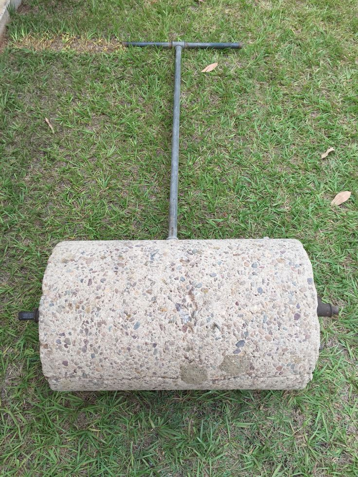 Prompt: Circle That is circular right. Anyway this is a roller we used to flatten our pebble driveway.