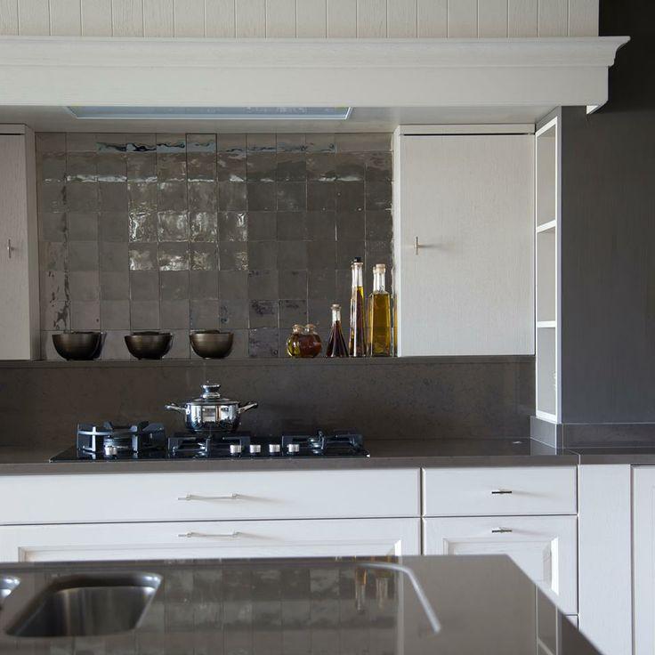 white contemporary kitchen - black stone countertops - beautiful fired clay tile backsplash