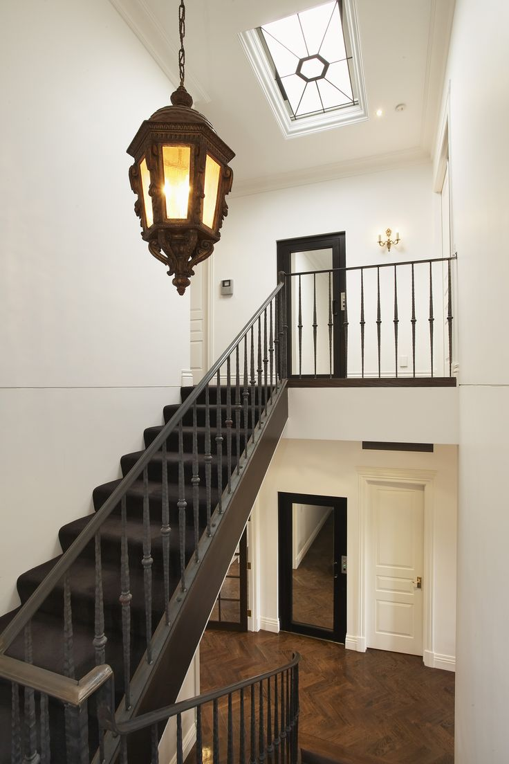 Staircase With Dark, Handrail, Baluster And Carpet Finish. Ravida- Property With Distinction