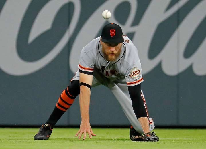 BEATEN BY THE BALL:   Hunter Pence of the San Francisco Giants fails to catch a double hit by Johan Camargo of the Atlanta Braves in the seventh inning at SunTrust Park on June 20 in Atlanta. The Giants won 6-3.