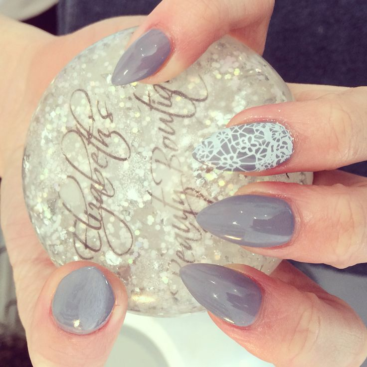 Clean slate grey with white lace detail acrylic extensions with gelish £30 for full details see www.elizabethsbeautyboutique.com