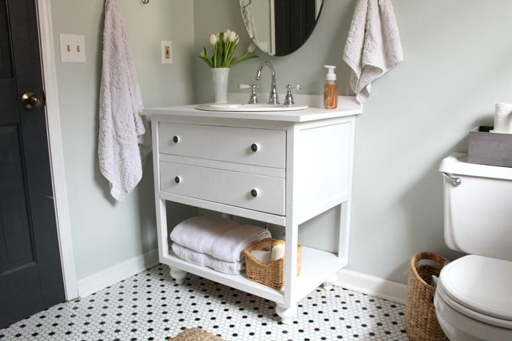 Vintage style bath vanity with two faux drawers as a cabinet door. Lower shelf for towel storage or other bath essentials. Vanity measures 30