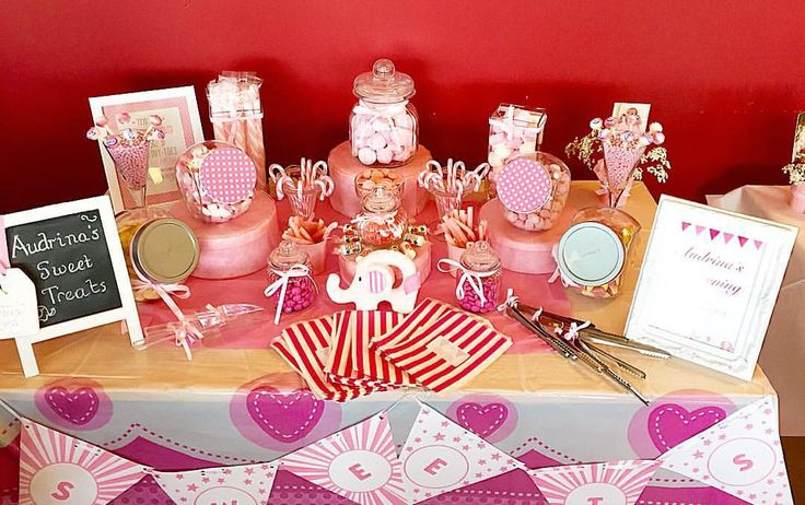 Pink sweet buffet with elephants and bunting for a christening