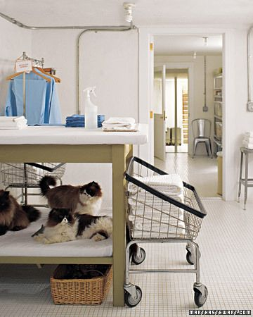 such a good idea. someday... when i have a house, I will buy commercial metal laundry carts, and some with hanging bars... it would be so easy to do laundry and distribute it! ..and it would really feel like a laundromat inside my house. which is just amusing.