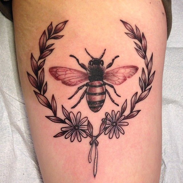 Laurel with bee Tattoo: Laurel leaves were kept outside of Apollo's temple to cleanse those before entering. They are also a symbol of strength. The Honey Bee signifies resurrection and strength.