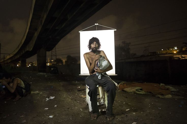 """Renato Dias, 39, writes in his notebook as he poses for a portrait in an open-air #crack #cocaine market, known as a """"cracolandia"""" or crackland, where users can buy crack and smoke it in plain sight, day or night, in Rio de Janeiro, Brazil, on March 17, 2015. Dias, who has been using crack for about four years, says he uses his notebook as a form of distraction. He writes about superheroes and dreams of becoming one."""