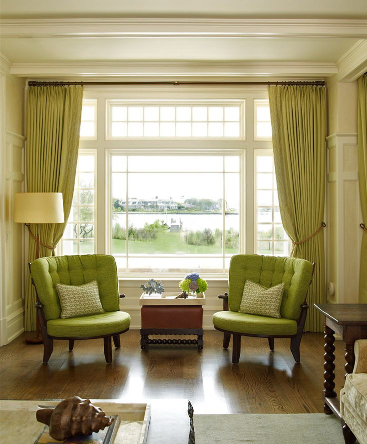 Green upholstered chairs placed in front of a window with a view - Austin Patterson Disston Architects   Portfolio   Country Houses   Shingle Style on the Bay