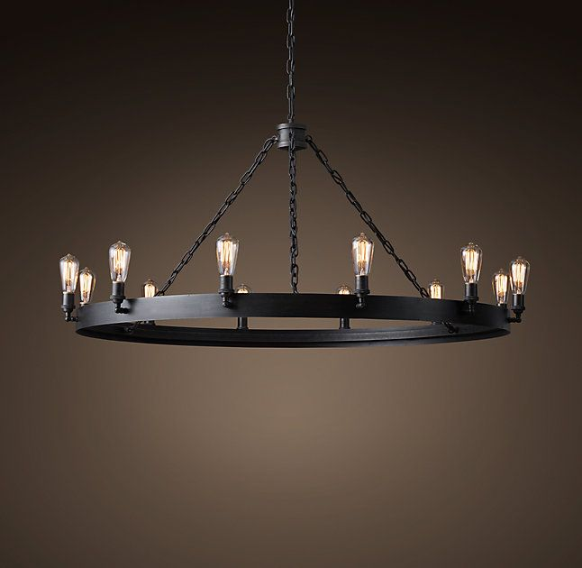 """RH's San Sebastian Round Chandelier 48"""":An antique Spanish chandelier is re-imagined in industrial iron in this statement-making fixture by Jon Sarriugarte. The Northern California blacksmith and artist crafts each chandelier by hand, using a mix of centuries-old techniques and modern innovation."""