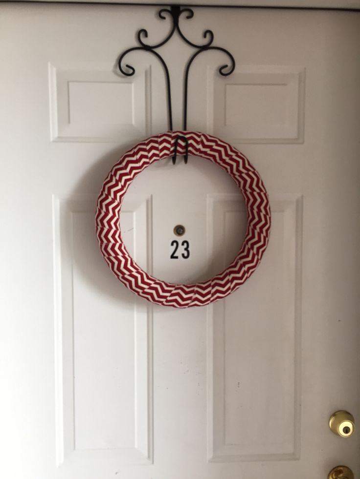 Simple ribbon wreath Wide ribbon. Hot glue to wreath, then wrap around the wreath. 4-6 yards of ribbon.