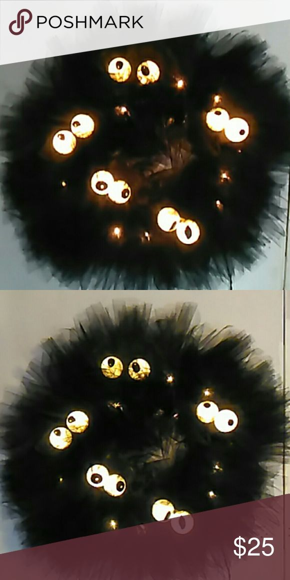 Halloween wreath This wreath features five sets of spooky eyes that will light up your door and delight your guests! Black tulle and eyes that light up are the perfect decoration this Halloween. Lights are included and comes completely assembled. Just plug it in an outlet and enjoy! Accessories