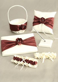 This beautifully wrapped satin rosewood collection is embellished with satin rosettes and finished with a sparkly rhinestone center.