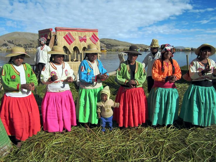 Indigenous inhabitants of one of the floating islands in Lake Titicaca greet a tour group from Puno, Peru.