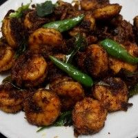 This Spicy Prawns fry is very easy to prepare and it taste awesome. It can be served as an appetizer or as an accompaniment to ghee rice .It is a treat for all prawns lovers. Do try this and you will surely love this spicy prawns fry. Directions In a bowl,take the cleaned prawns.To that add   Read More ...