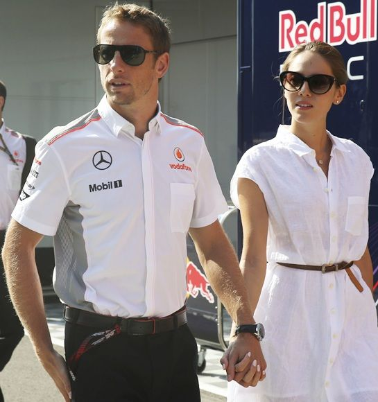 McLaren Formula One driver Jenson Button of Britain and his girlfriend, Japanese-Argentine model Jessica Michibata
