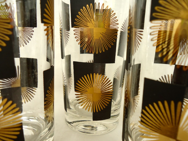 Set of 25 MINT Mid Century /Atomic/Modern/Mad Men SUNBURST Pattern COCKTAIL/Barware/Lo/High Ball/Rocks/Shot  Glasses/Black and Gold, via Etsy.