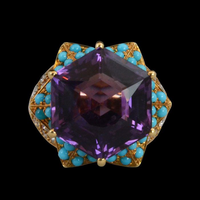 Amethyst, Turquoise and diamond ring centering on a hexagonal amethyst within a star frame set with cabochon turquoise, the shoulders set wi...