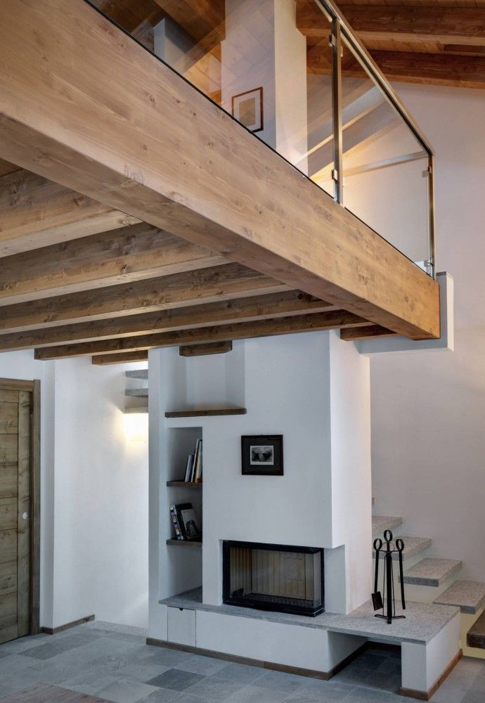 Stable/barn converted into Contemporary home that revise some important elements of the old building.  Architects: Enrico Scaramellini Architetto