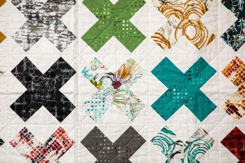This ultra modern quilt has a beautiful neutral plus jewel tone colour palette.