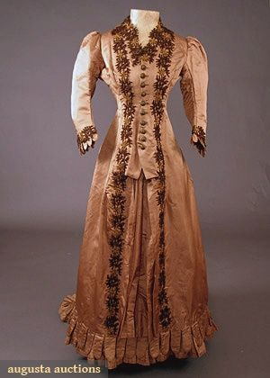 PHOEBE APPERSON HEARST BUSTLE DRESS, 1870's 1-piece cinnamon silk satin trained bustle dress, beaded applique trim & brass buttons, 3/4 gathered sleeves, original bustle tapes & buckram linings.