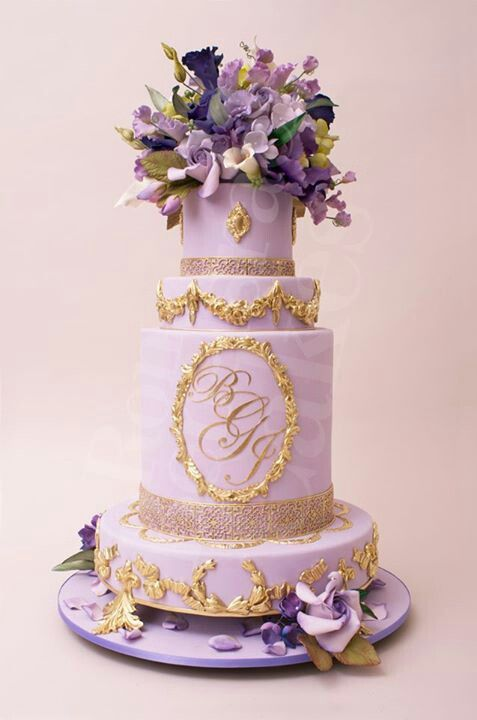 Wow..weddibg cake with gold trim and monogram