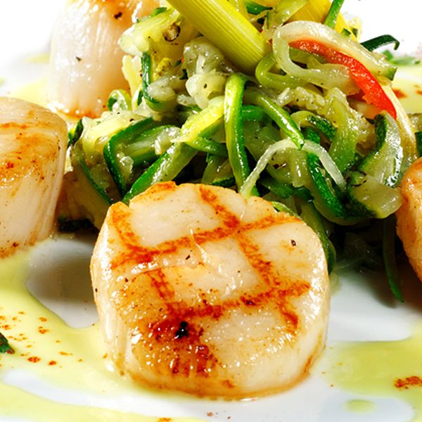 A grilled scallop recipe with a creamy yellow pepper sauce.