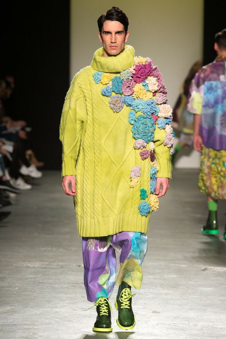 RACHEL JAMES - GRANNY FLOWER MAN POWER  Oversized Aran hand knitted sweater with crocheted flowers and printed leather shorts