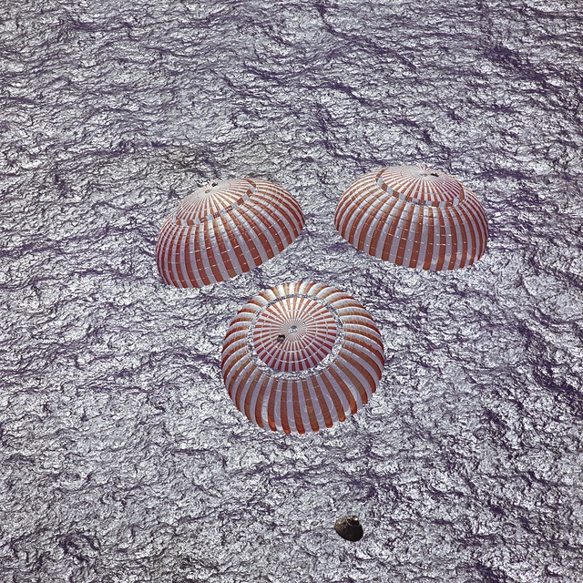 The Apollo 16 command module, with astronauts John W. Young, Thomas K. Mattingly II and Charles M. Duke Jr. aboard, nears splashdown in the central Pacific Ocean to successfully conclude a lunar landing mission. This overhead picture was taken from a recovery aircraft seconds before the spacecraft hit the water. The splashdown occurred at 290:37:06 ground elapsed time at 1:45:06 a.m. (CST), April 27, 1972, at coordinates of 00:43.2 degrees south latitude and 156:11.4 deg