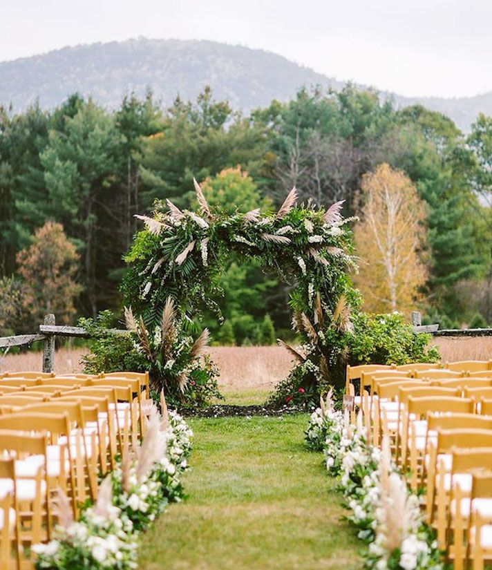 Pampas Grass Is The Underrated Plant Every Outdoor Wedding Needs Outdoor Wedding Outdoor Wedding Reception Decorations Outdoor Wedding Reception