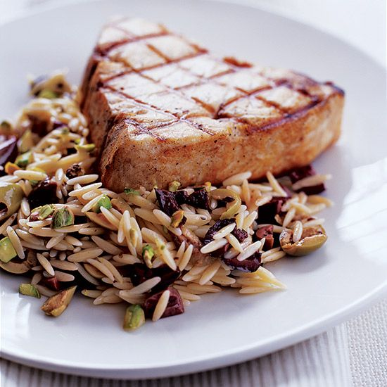 Swordfish with Orzo, Pistachios and Olives | A staff-favorite, this delicious recipe can be whipped up in a quick 25 minutes.