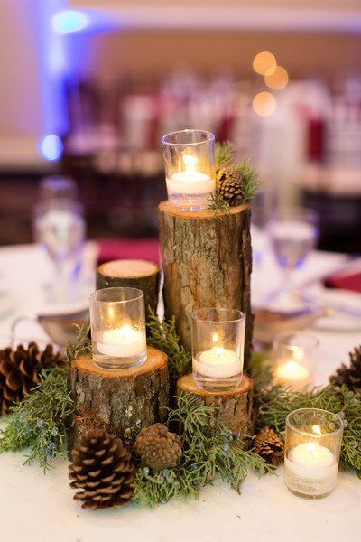 Winter-themed wedding centerpiece idea - tree branches, pinecones and candles - #weddingcenterpiece {Candice Adelle Photography} #WeddingIdeasTheme