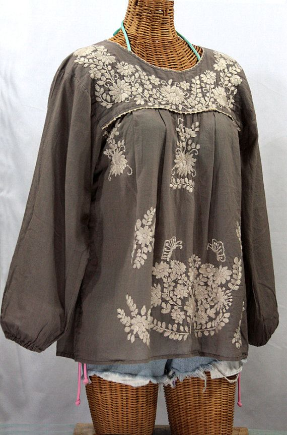 Our vintage Mexican-styled La Mariposa Larga long-sleeved peasant blouse features flowers and butterflies artfully embroidered by hand. Made of light