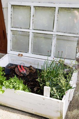 wow great ideas- cute old window grow box-lidded for early planting and a horseshoe to lay tools on instead of directly on the ground.