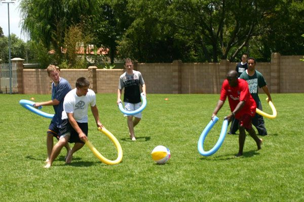 Teams play a kind of hockey where you could only hit a beach ball with pool noodles.