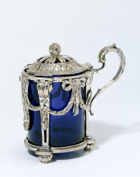 "1773-1774 French Mustard pot at the Victoria and Albert Museum, London - From the curators' comments: ""Classical pilasters, hung with laurel swags tied with bows, form the framework for this Parisian mustard pot, of a type popular in the two decades before the French Revolution. Like salt, mustard corrodes silver, so a blue-glass liner forms the pot and offers a deep background to offset the silver."""