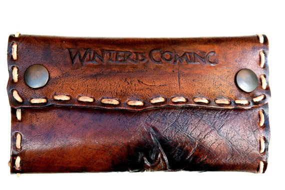 Made of natural thick leather,painted,with two handmade engraves,inspired of the series Game Of Thrones. In front the phrase the winter is