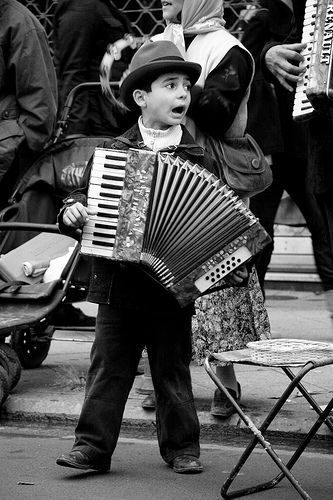 A family of street musicians, this one being the youngest.