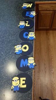 Want to welcome your students to another fabulous school year? This cute minion welcome sign is handmade with colored cardstock and is adorable. Your students will love to see the minions from Despicable Me right outside or inside your classroom in the fall!Want more minion decorations?