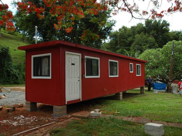 Hawaii Single Container Housing Hawaii Single Container Housing This is a combination office and apartment featuring office space, kitchen, bath and bedroom.  The addition  of T-111 siding and a flat roof improves the durability of the unit and enhances its appearance.