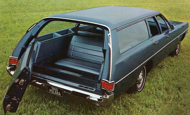 1969 Dodge Polara Station Wagon.  Riding backwards in the back. My sister and I would ride in back all the way to or Grandparents little cabin on a lake in Michigan. We both thought it was great fun to snap pictures of people w just to see their reaction.  The camera had no film.