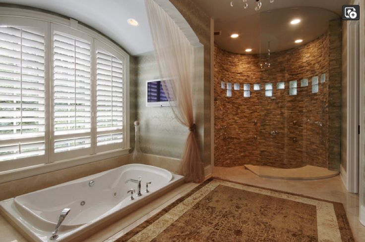 Master Bathroom with sunken bathtub and steps-down sunken ...