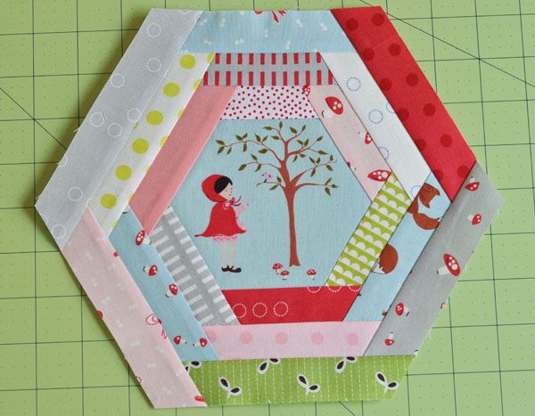hexagon log cabin block. There is a second part tutorial where she shows you how to put the blocks together