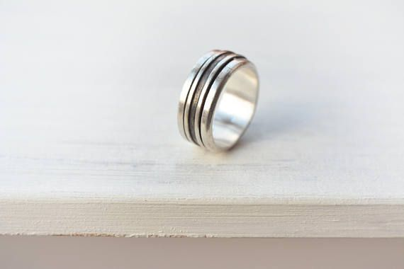 These are two minimalist design spinner rings made out of Sterling Silver. Vintage simple design stress reliever rings. The middle part spins freely over the larger inner band! I am told you can fidget with it and spin it and relieve stress in such a way during the day. Both rings on the