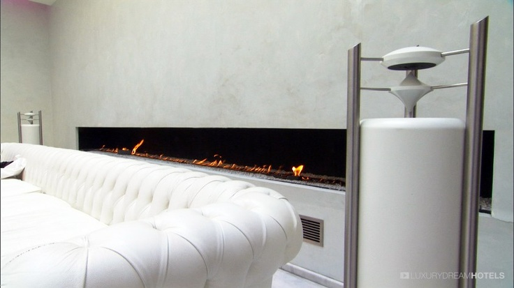 Urban temple with, in the center of the hotel, a six meter long white #Chesterfield couch and a fireplace of the same size and color - Murano Urban Resort, #Paris, #France  #luxurydreamhotels