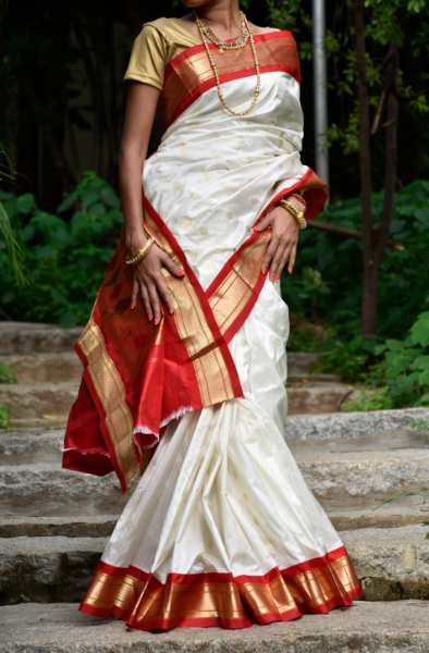 Pearl white and red paithani saree with narayan border.