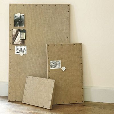 Make any old bulletin board or piece of pine board into a Burlap bulletin boards with brass pins.