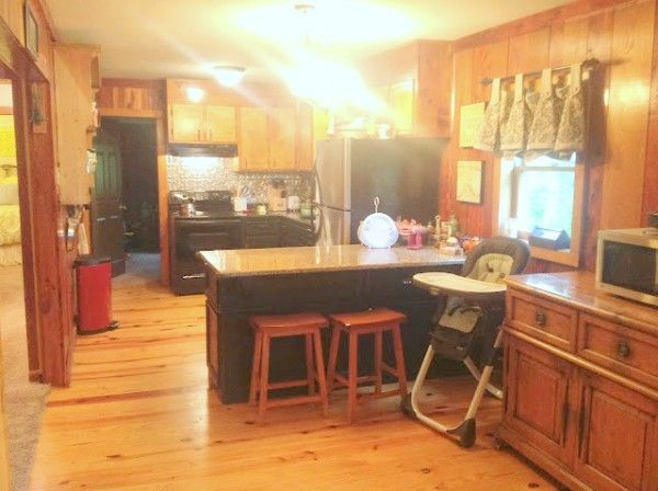 The Power of Paint – Amazing Wood Paneling Makeover - wood paneled kitchen before