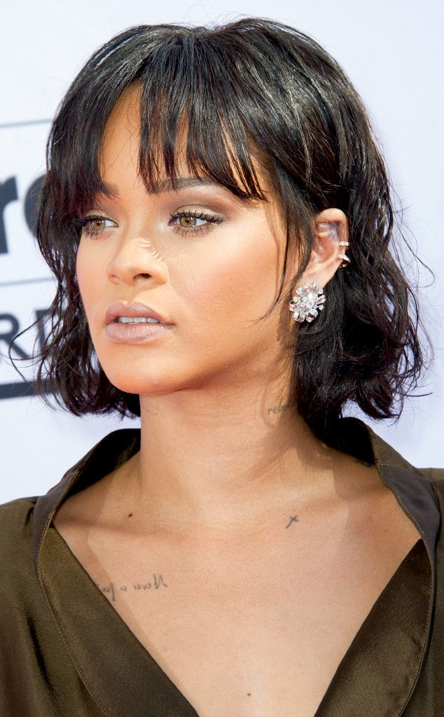 If you're more comfortable rocking dainty jewelry, take note of Rihanna's minimal ear style.